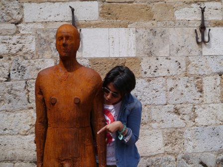 I don't think she's taking that Anthony Gormley sculpture at all seriously!