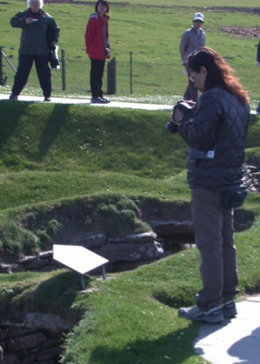 Photographing panels at Scara Brae, World Heritage Site, Orkney