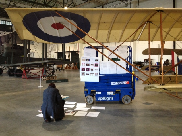 Reviewing draft texts in situ in the Grahame White building, Royal Air Force Museum, Hendon